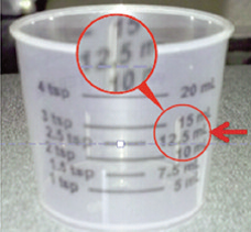 dosing cup with markings